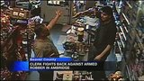 Clerk with gun fights off robbery attempt_3640764