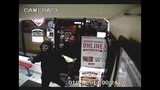Surveillance images of armed robbery at… - (1/3)