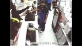 Surveillance images of armed robbery at… - (2/3)