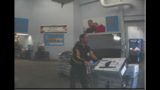 Surveillance photos of Walmart robber - (4/4)