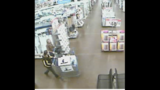 Surveillance photos of Walmart robber - (1/4)