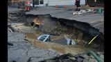 PHOTOS: Massive sinkhole swallows car - (13/25)