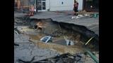 PHOTOS: Massive sinkhole swallows car - (23/25)