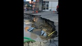 PHOTOS: Massive sinkhole swallows car - (20/25)