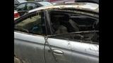 PHOTOS: Massive sinkhole swallows car - (18/25)