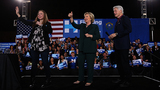(L-R) Chelsea Clinton, Democratic presidential candidate former Secretary of State Hillary Clinton and former U.S. president Bill Clinton greet a crowd on February 19, 2016 in Las Vegas, Nevada. (Photo by Justin Sullivan/Getty Images)