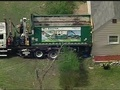 1 hospitalized after waste management truck rolls into house