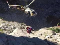 Rescue helicopter hits safety rope, nearly crashes into mountain