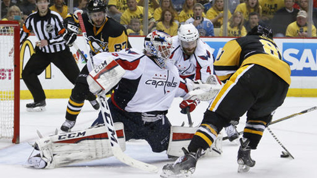 Pittsburgh Penguins' Phil Kessel shoots and scores on Washington Capitals goalie Braden Holtby during Game 6 of the NHL hockey Stanley Cup Eastern Conference semifinals, Tuesday, May 10, 2016 in Pittsburgh. (AP Photo/Gene J. Puskar)