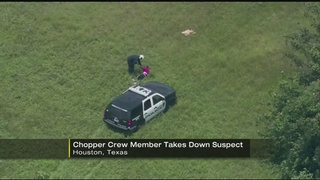 Helicopter police crew lead dramatic open-field capture of suspect