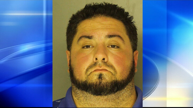 Probation officer charged with intimidating witness