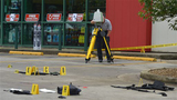 A TBI technician uses a laser mapper in the O'Reilly Auto Parts parking lot to document the crime scene connected to the shooting on Volunteer Parkway early Thursday morning, July 7, 2016. (Andre Teague/Bristol Herald Courier via AP)