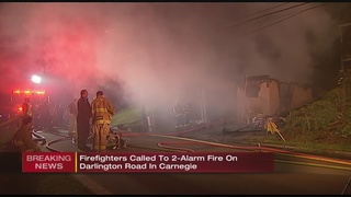 Flames blocking doorway traps family inside Carnegie home