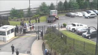 RAW: Truck smashes through gate at FBI