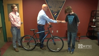 Troopers buy shoeless teen a bike so he can get to work