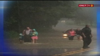 Veteran firefighter speaks about rescuing woman, her daughters from flood waters