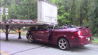 Man flown to hospital after car goes under flatbed of tractor-trailer