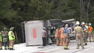 RAW: Tri-axle truck overturns, spills load after accident in Washington Township