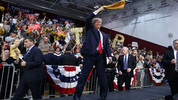 Republican presidential candidate Donald Trump waves a