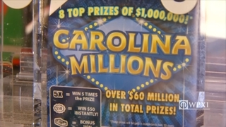 Wife wins $1 million trying to show husband lottery tickets are waste of money