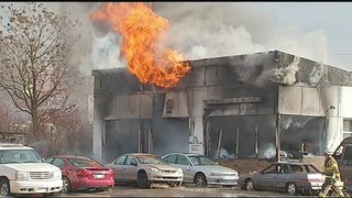 Firefighters battle flames at service garage in Hill District; 1 person injured