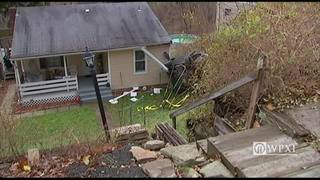 RAW: Car strikes house after going over hillside in Penn Hills