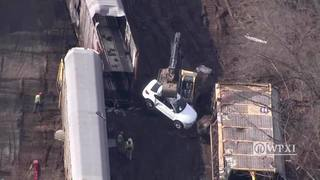 BMW carnage litters train tracks after derailment