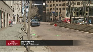 Woman dies after being hit by bus in downtown Pittsburgh