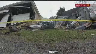 Man wanted for driving without license, crashing through garage