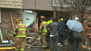 Car crashes through townhouse in Plum; elderly driver taken to hospital