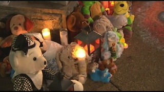 Vigil held for 4-year-old boy, man wanted for questioning in custody