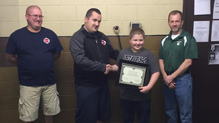 Elementary student honored for putting out fire
