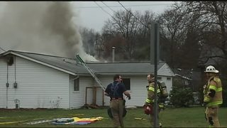 Police officers rescue men from burning home