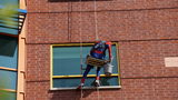Photos: Superheroes wash windows at… - (13/21)