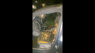 PHOTOS: Damage to car set on fire with woman, child inside