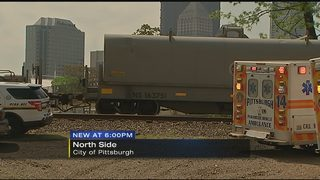 2 men in critical condition after being hit by train