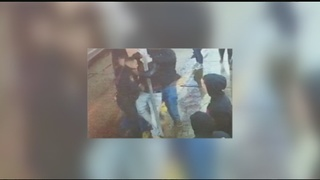 Photo appears to show man choking police officer accused of assault