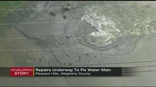 Crews continue working to repair water main break that closed road