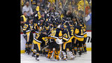 PHOTOS: Penguins prevail in thrilling double-OT Game 7