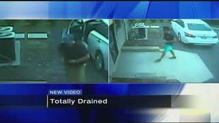 Surveillance video shows two men draining North Hills ATM