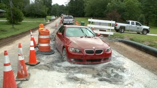 VIDEO: Driver gets BMW stuck in fresh concrete