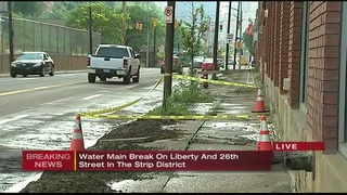 Water main break causes flooding on Strip District street