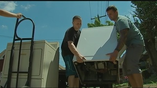 Volunteers providing free washers, dryers to flood victims