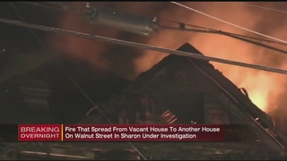 Fire destroys vacant home, jumps to neighboring house