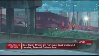 Driver rescued, Parkway traffic snarled in fiery crash