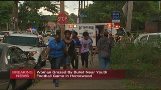 Woman grazed by bullet during youth football