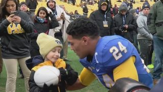 Family of cancer-stricken boy supports Conner in Steelers debut