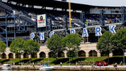 PNC Park, the home of Major League Baseball's Pittsburgh Pirates is seen along the north shore of the Allegheny River in Pittsburgh, Wednesday, July 26, 2017. (AP Photo/Keith Srakocic)