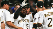 Pittsburgh Pirates' Josh Harrison (5) is congratulated by teammates after hitting a walk-off home run to beat the Los Angeles Dodgers and break up the no-hitter by Dodgers starting pitcher Rich Hill. (AP Photo/Keith Srakocic)