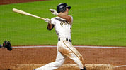 Pittsburgh Pirates' Adam Frazier hits a walk-off, two-run home run off Milwaukee Brewers relief pitcher Corey Knebel in the ninth inning of a baseball game, Wednesday, Sept. 20, 2017 in Pittsburgh. The Pirates won 6-4. (AP Photo/Gene J. Puskar)